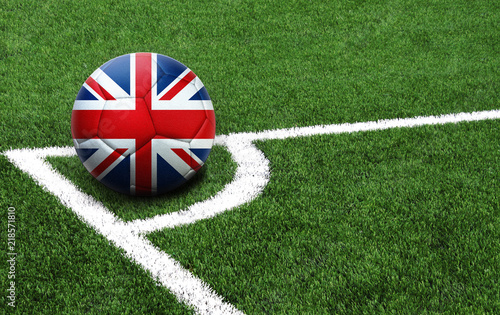 Fototapeta  soccer ball on a green field, flag of United Kingdom