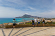 Tourists enjoying the view over the Costa Blanca from Altea, Spain