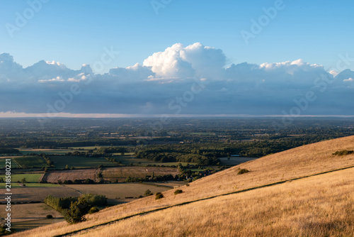 Foto op Aluminium Blauw Stunning Summer sunset landscape image of South Downs National Park in English countryside
