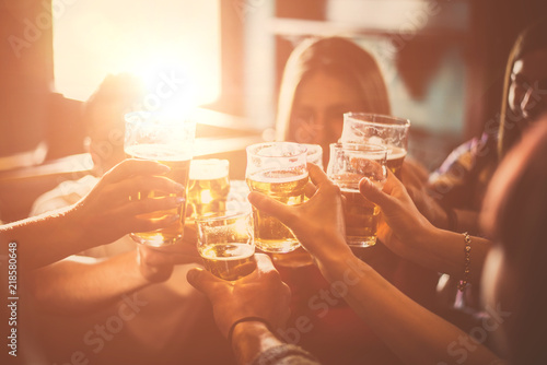 Group of teens having fun in a pub