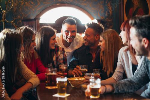 Fototapeta Group of teens having fun in a pub obraz