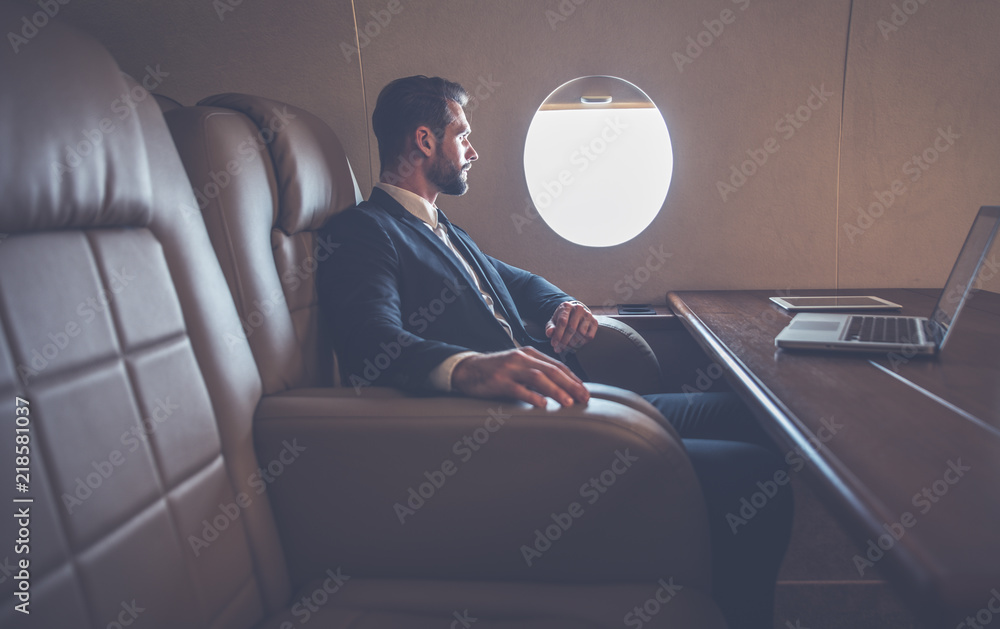 Fototapety, obrazy: Businessman flying on his private jet