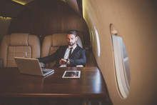 Businessman Flying On His Priv...