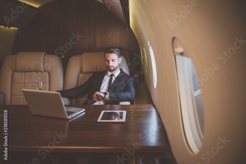Cuadros en Lienzo Businessman flying on his private jet