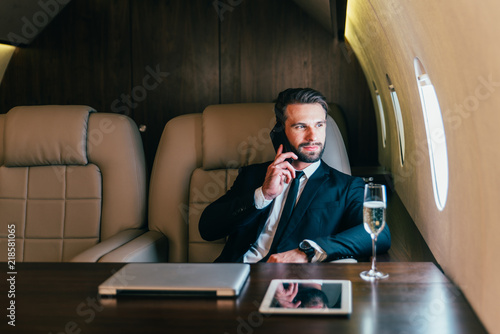 Fototapeta Businessman flying on his private jet obraz