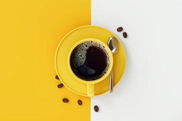 Pogled odozgo na šalicu kave na žutoj i bijeloj pozadini.