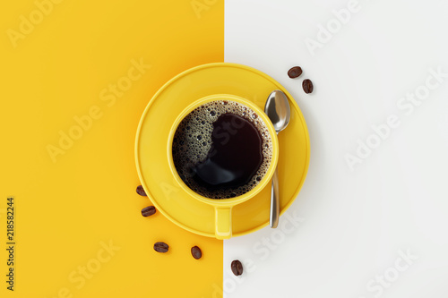Top view of coffee cup on yellow and white background.