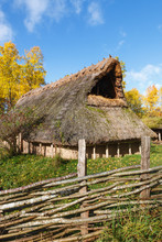Long House With A Branch Braided Fence In Autumn