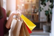 Asian Girls Holding Sale Shopp...