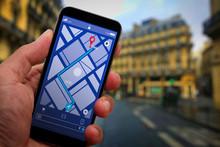 Close Up Of Tourist Using GPS ...