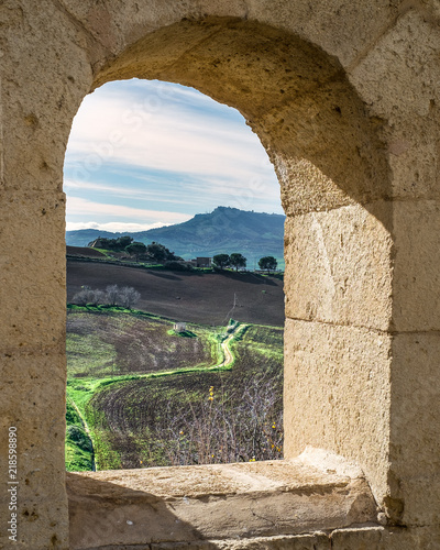 Foto op Plexiglas Toscane Sicilian inland landscape seen through an old stones window