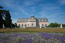 View Of Schloss Benrath, Old Classic Residence Palace And Small Garden With White And  Purple Garden In Front Of Building In Dusseldorf, Germany