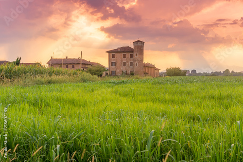 Foto op Canvas Pistache farmhouse in the countryside at sunset