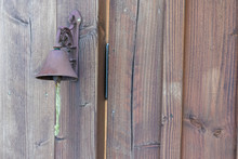Rusty Iron Bell Hanging At A W...