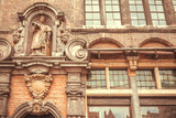 Middle ages facade of historical house with sculptures and decor in Ghent, Belgium. Example of architecture of old Europe