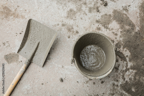 Shovel And Empty Cement Bucket On The Floor After Buildings Construction Top View