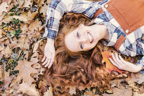 Valokuva  young beauty red hair in leaf