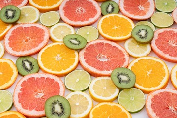 oranges ,grapefruit, and other fruits sliced