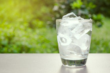 Glass Of Ice And Water In Put ...