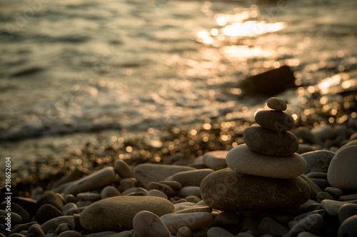 Foto op Aluminium Cathedral Cove stack of zen stones on pebble beach