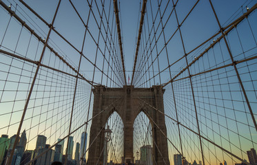 Brooklyn bridge in new york with a geometric perspective at sunset
