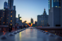 Blurred Night Lights Of The New York With Metal Part Of Bridge Foreground
