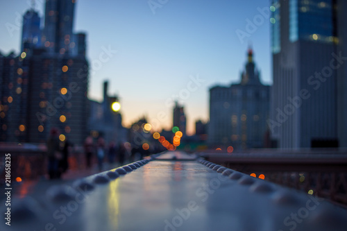 Fotografia, Obraz  blurred Night lights of the New York with metal part of bridge foreground