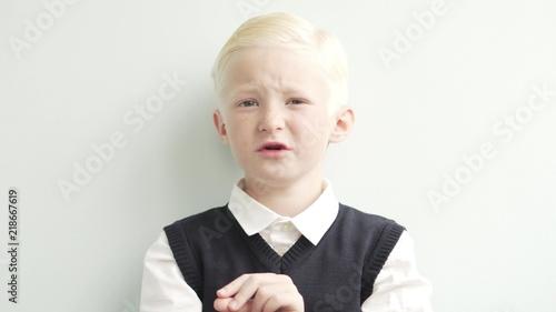 Fotografie, Obraz  little schoolboy. Close-up of a blond boy in school uniform