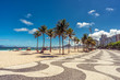 Palms on Copacabana Beach and landmark mosaic sidewalk in Rio de Janeiro, Brazil.