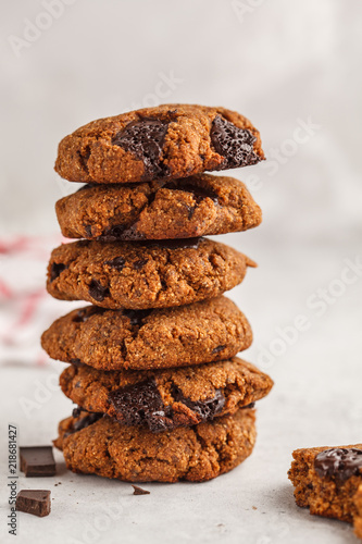 Tuinposter Koekjes Stack of healthy vegan cookies with chocolate, white background. Clean eating concept.