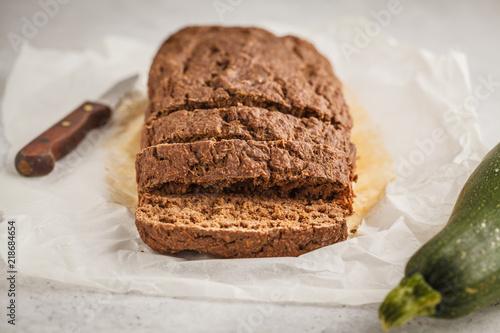 Chocolate vegan zucchini bread, white background.