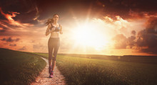 Fit Determined Woman Running A...