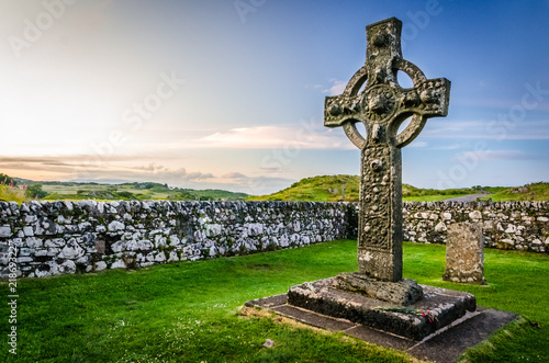 Tablou Canvas Stone religious celtic Kildalton cross on a cemetary beside a church on Islay is