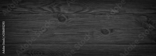 Panorama czarnych desek, ponura struktura drewna, ciemne tło