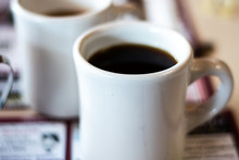 Coffee In A Mug On A Table Wit...