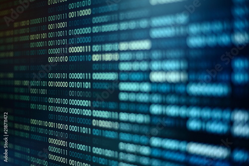 Fototapeta computer technology background. binary code computer language data transfers. big data and ai artificial intelligence cyber network. digital business environment. obraz na płótnie