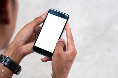 Fototapety, obrazy: Man holding mockup smartphone on hands.