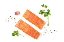 Slices Of Salmon With Parsley, Garlic And Pepper, On A White Background With Copy Space, Overhead Photo