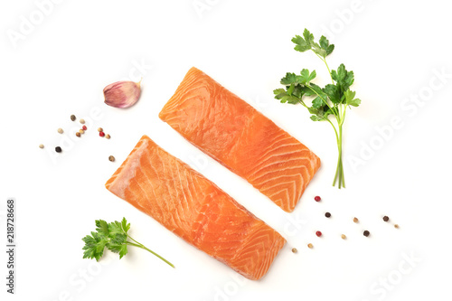 Slices of salmon with parsley, garlic and pepper, on a white background with cop Tableau sur Toile