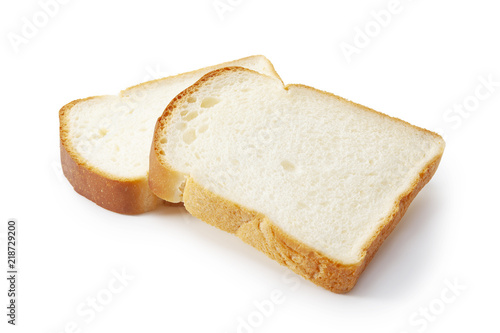 Fotografering Slice of white bread isolated on white