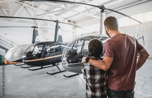 Fotografía Father hugging son while watching at rotorcraft