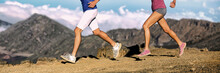 Trail Running Athletes Legs Of Runners Shoes And Shorts, Sportswear Cross-country Running On Volcano Rocks Difficult Trail Landscape. Banner Panorama. Woman And Man Lower Body Section Closeup.