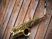 Saxophone On A Wooden Background