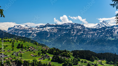 Switzerland, Beatenberg village and Alps view
