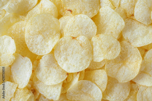 Fotografía crispy potato chips snack texture background