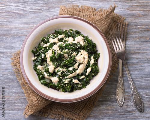 Stewed kale with tahini sauce and sesame seeds