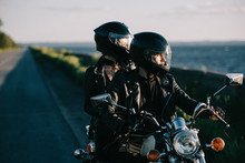 Couple Of Bikers In Helmets Ri...