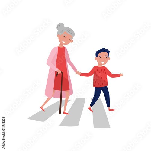 Valokuvatapetti Polite boy helps elderly woman to cross the road