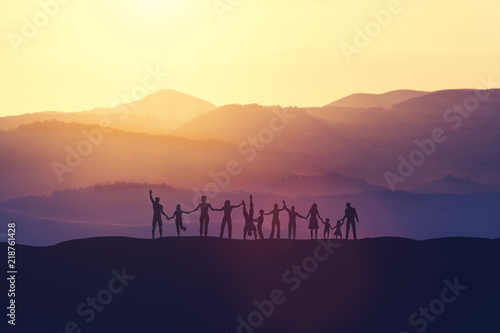 Group of happy people at sunset Wallpaper Mural