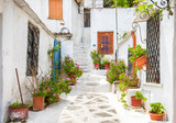 Fototapeta Uliczki - Old street in Anafiotika in Plaka district, Athens, Greece. Vintage houses near Acropolis.